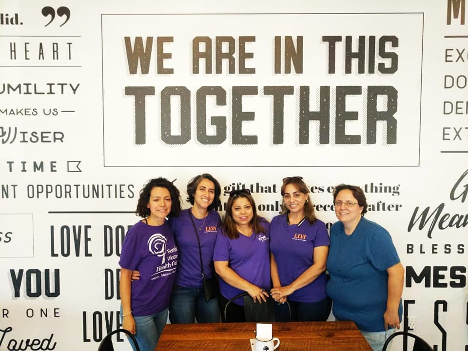 Group of members posing in front of a backdrop at a past LLVI Health Fair.