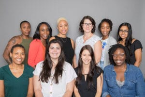 A group of former members of the Errin J. Vuley Fellows Program smile at the camera.