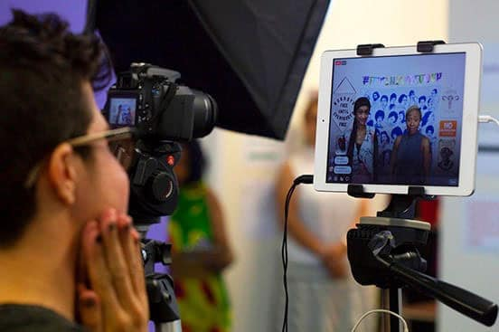 A videographer records a video of Feminist Women's Health Center staff members speaking on important issues.