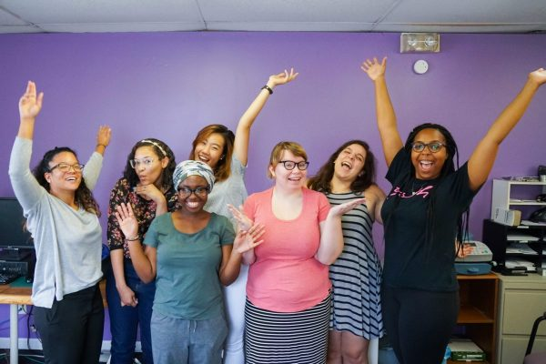 A group of interns poses for a light-hearted picture in the Feminist Women's Health Center offices.