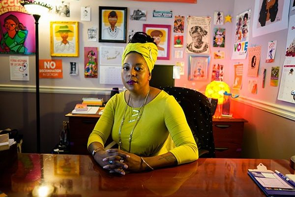 Feminist Women's Health Center Executive Director, Kwajelyn Jackson, sits at the desk in her office.