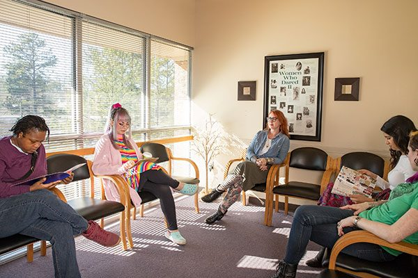 Models pose as patients in the Feminist Women's Health Center waiting area.